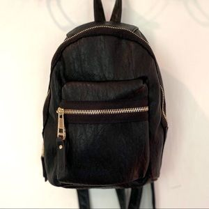 Madden Girl Mini Backpack in Black Faux Leather